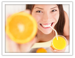 Lady drinking healthy fruit juice
