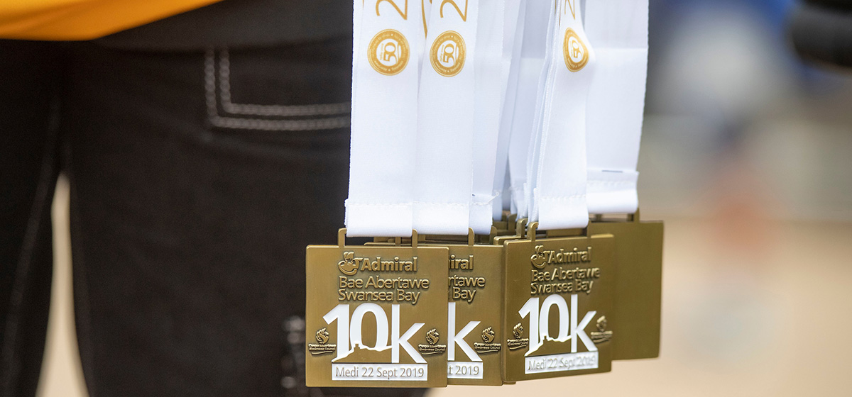 A photo of the medals from the 2019 Admiral Swansea Bay 10k